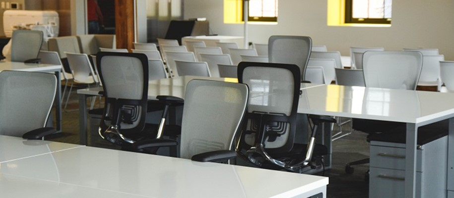 an office of ergonomic chairs